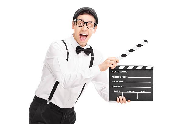 junge hält ein erste klappe fällt film director - klappe hut stock-fotos und bilder