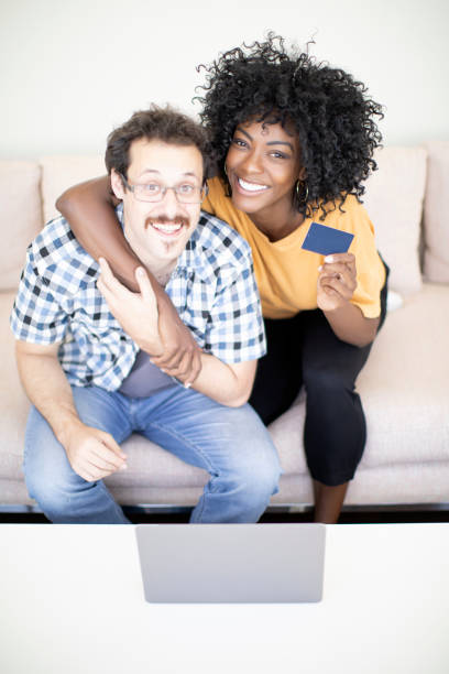 Young multi-ethnic couple shopping online stock photo