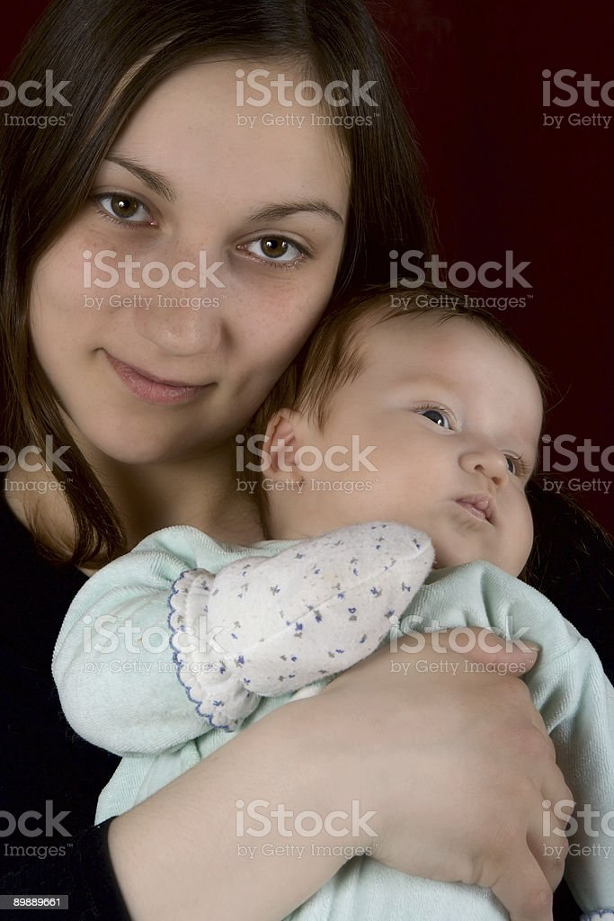 Young mum of the embracing favourite son royalty-free stock photo