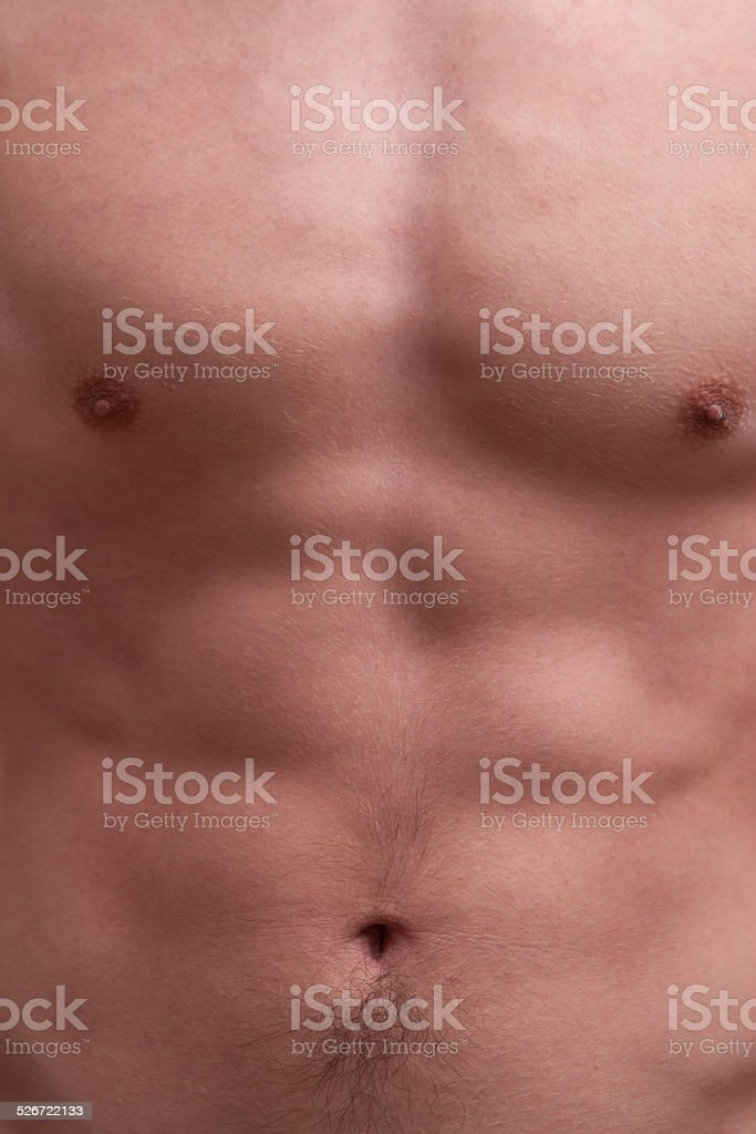 young muscle man chest and abdominals stock photo