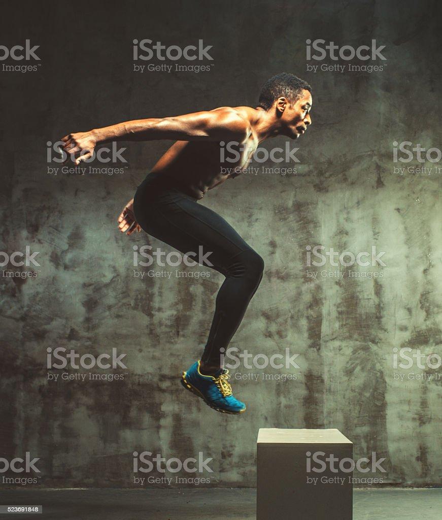 young muscular doing cross training stock photo