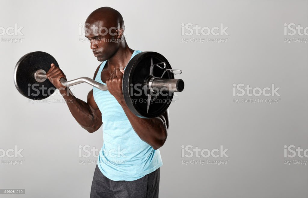 Young muscular man exercising with weights royalty-free stock photo
