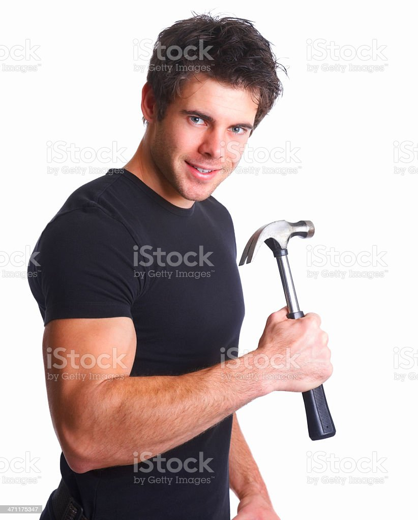 Young muscular man holding a hammer stock photo