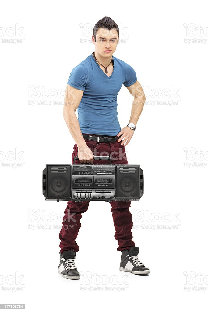 Young muscular man holding a radio royalty-free stock photo