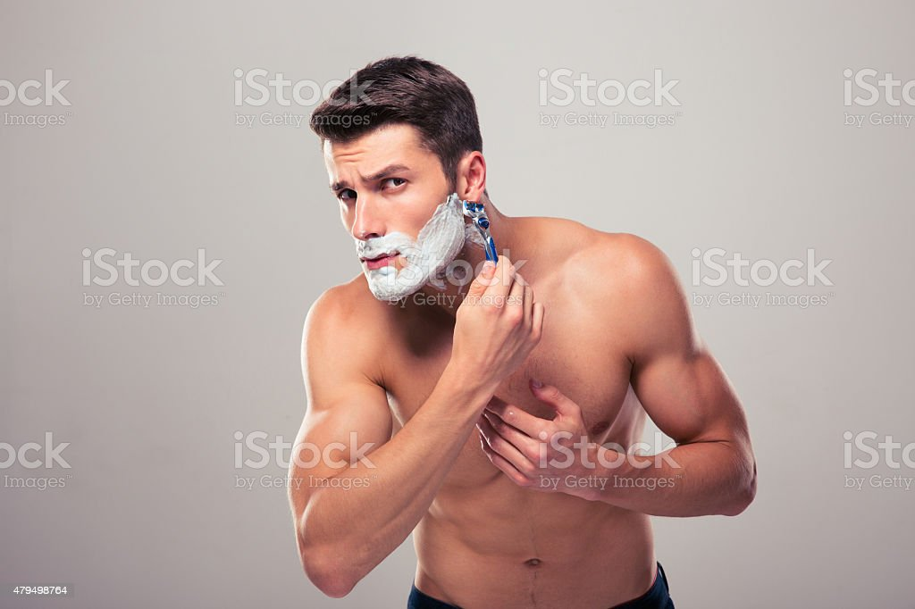 Naked men shaving