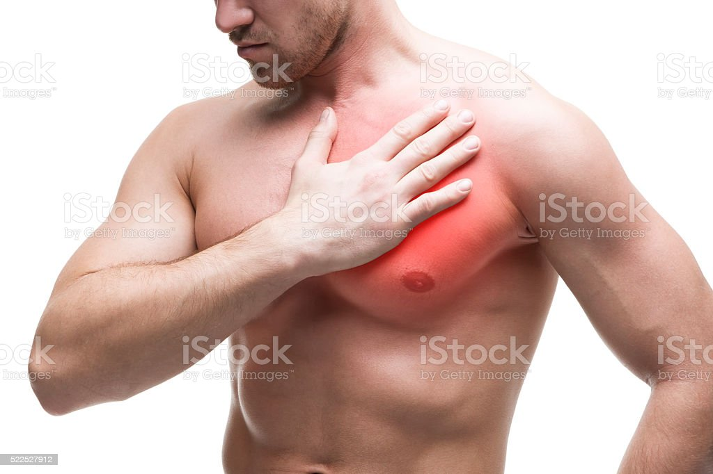 Young muscular man with chest pain isolated on white background stock photo