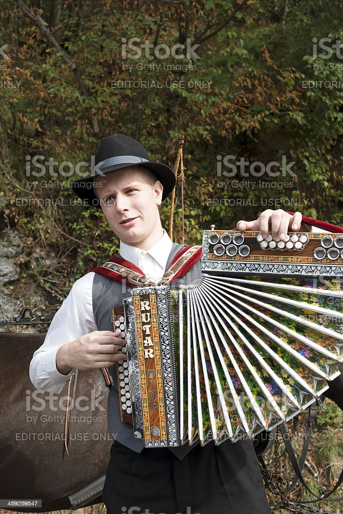 Young Musician Playing Accordion Slovenia stock photo