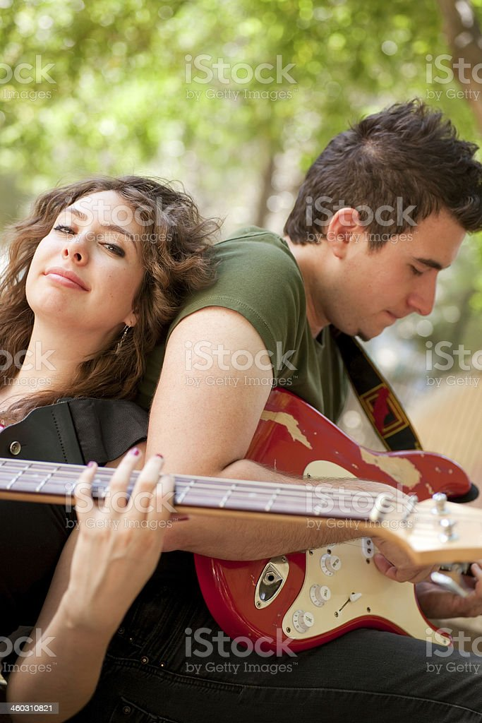Young Musicians playing guitar in the park stock photo