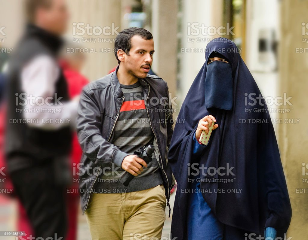 Young Muslim couple walking in Old Prague stock photo