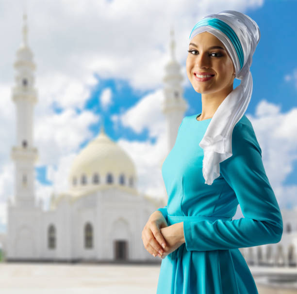 Young muslim girl at mosque background stock photo