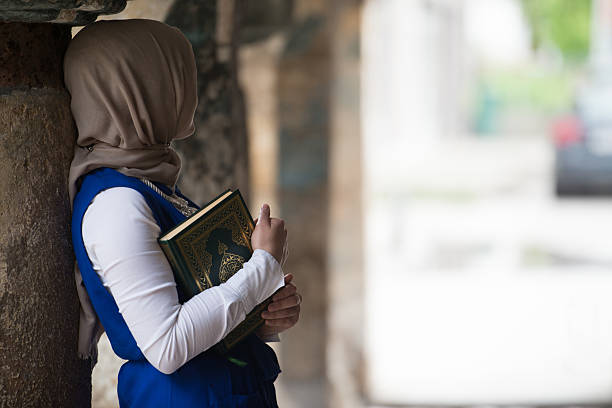 Young Muslim Girl Reading The Koran stock photo