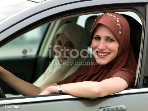 istock Young muslim girls in a car 154907692