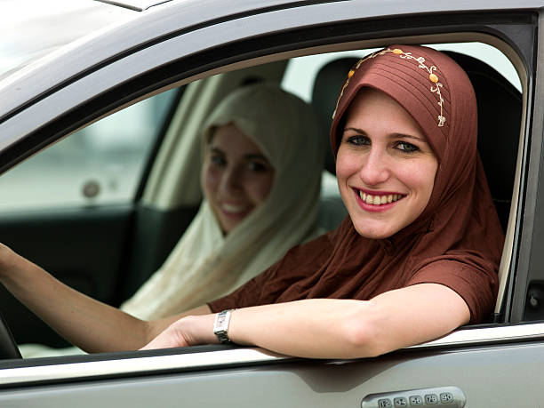 young muslim girls in a car - arabic girl stock photos and pictures