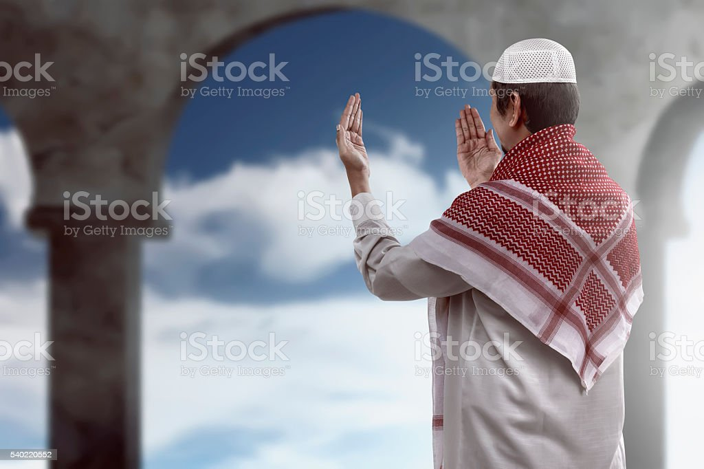 Young muslim man praying stock photo