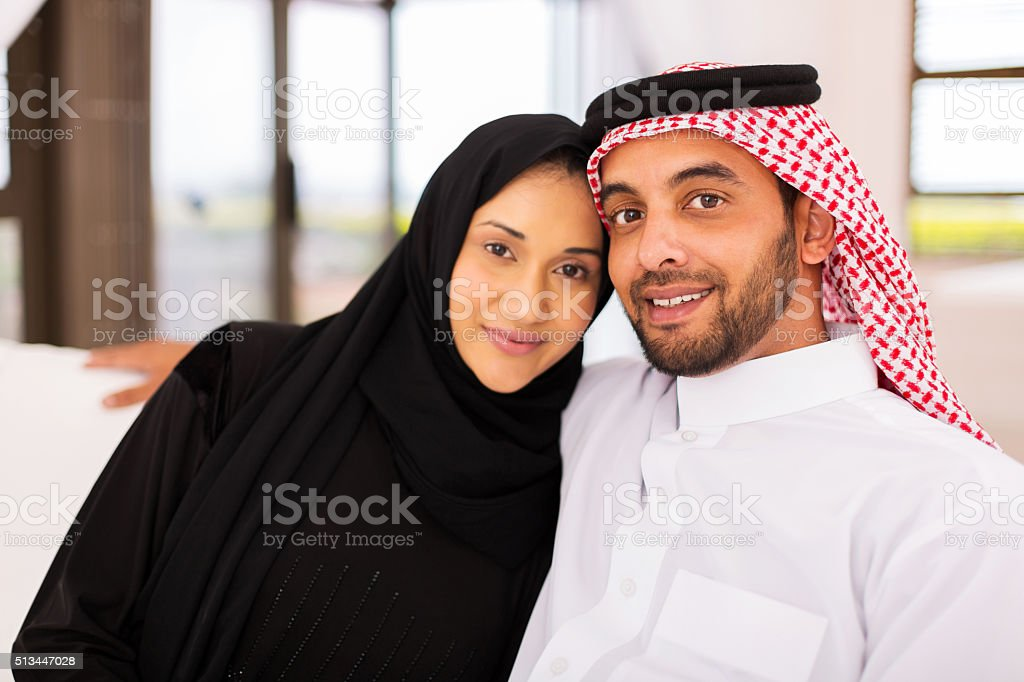 young muslim married couple stock photo