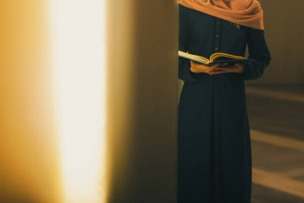 Young muslim woman read Quran stock photo