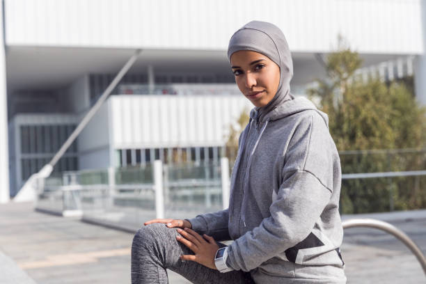 young muslim woman ready to running in the city - arabic girl stock photos and pictures