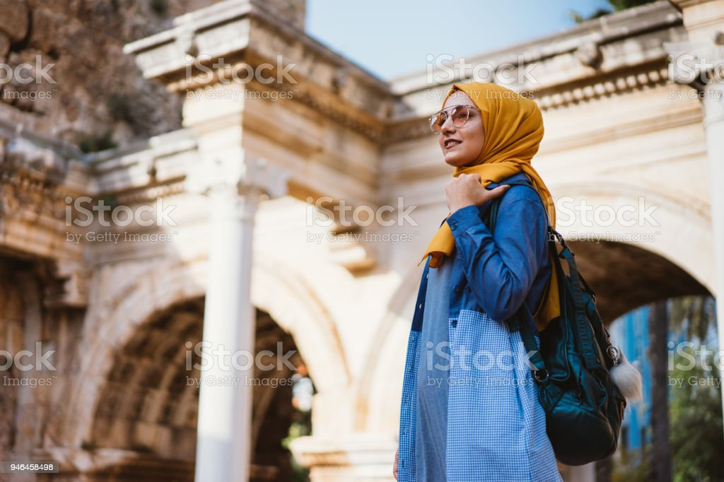 Young muslim woman traveller in Kaleici (old town of Antalya) stock photo
