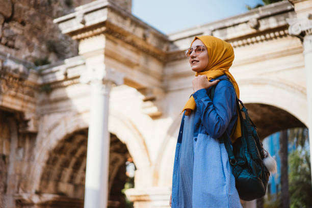 Young muslim woman traveller in Kaleici (old town of Antalya) Young muslim woman traveller in Kaleici (old town of Antalya) turkey middle east stock pictures, royalty-free photos & images