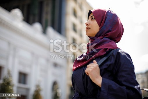 Young muslim woman travelling