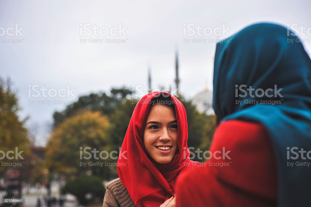 Young Muslim Woman with a friend stock photo