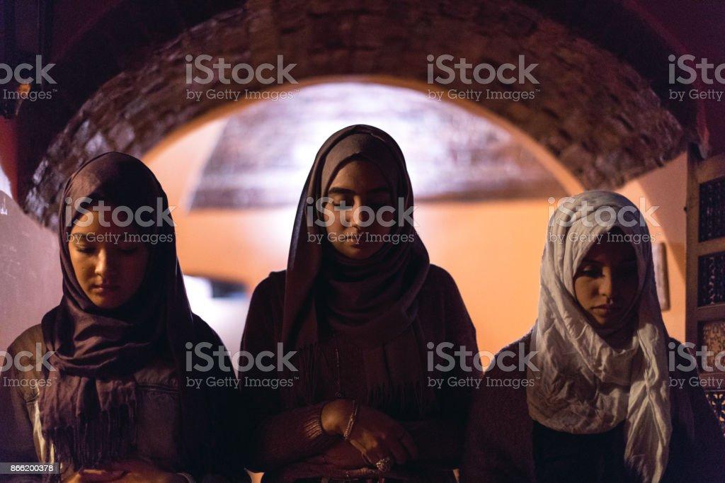Young Muslim Women praying stock photo