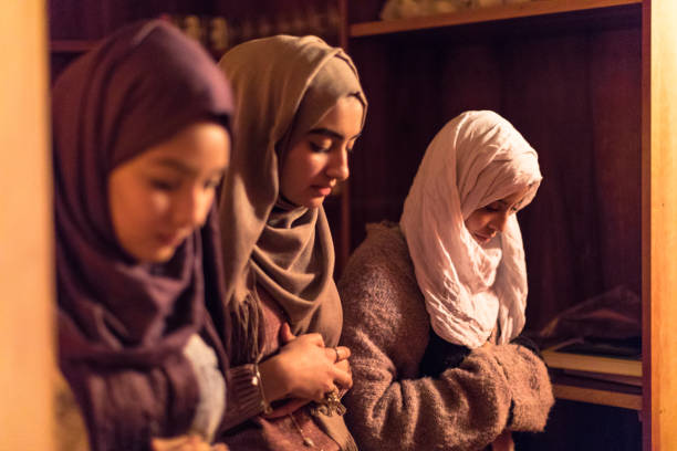 Young Muslim Women praying stock photo