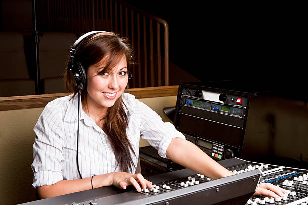 Young Native American Woman at a Recording Console stock photo