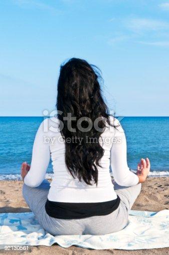 istock Young native american woman meditating 92130561