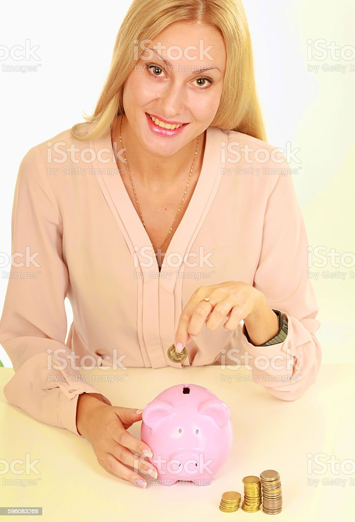 Young natural woman holding piggy box ,standing in office royalty-free stock photo