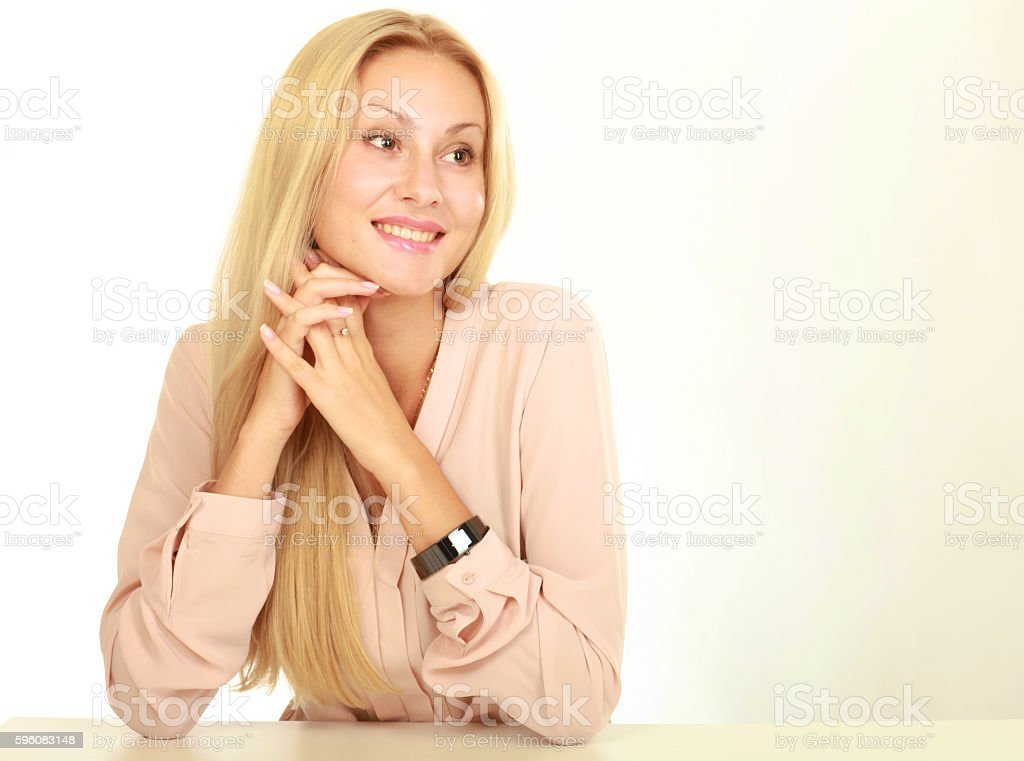 Young natural woman with clean face sitting at white table royalty-free stock photo
