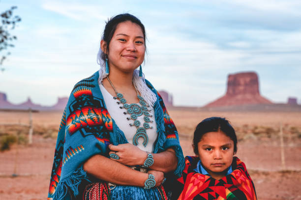 A Young Navajo Brother and Sister Who Live In Monument Valley, Arizona Native American sister and little brother posing for photographs in their native costumes indigenous peoples of the americas stock pictures, royalty-free photos & images