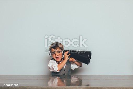 992091590 istock photo Young Nerd Boy Listening with Megaphone 1186931781