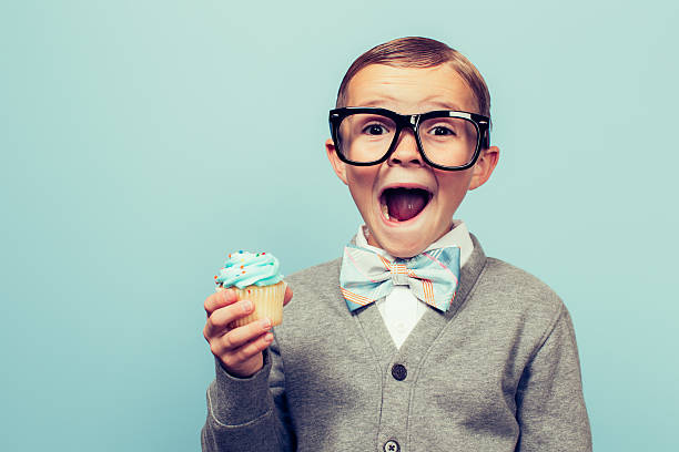 young nerd boy loves dessert - nerd boy eating stock photos and pictures