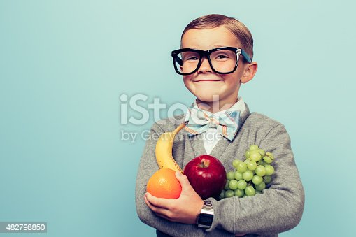 istock Young Nerd Boy Loves Eating Fruit 482798850