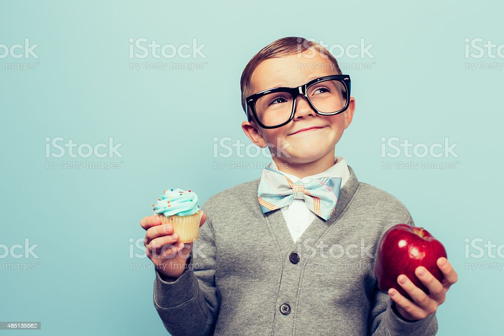 Young Nerd Boy Loves Healthy Food Choices stock photo