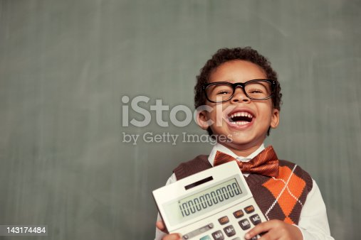 istock Young Nerd Boy Wearing Glasses Holding Calculator 143174484