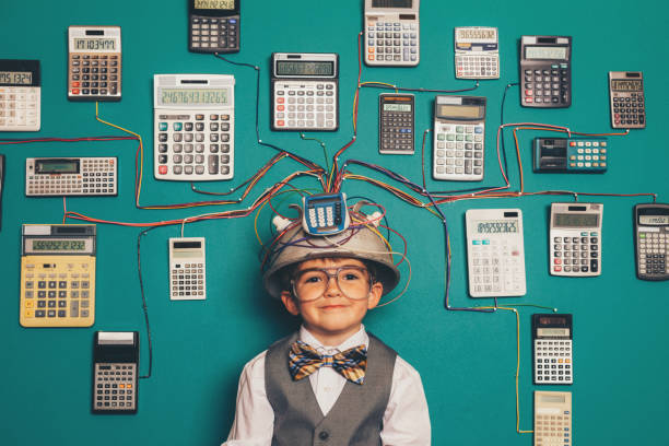 Young Nerd Boy with Calculator Invention stock photo
