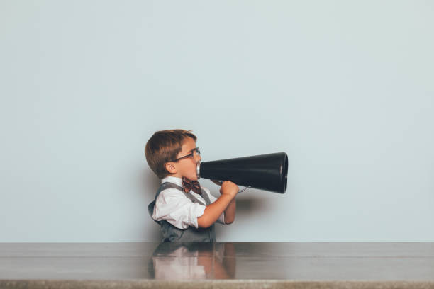 Young Nerd Boy with Megaphone stock photo