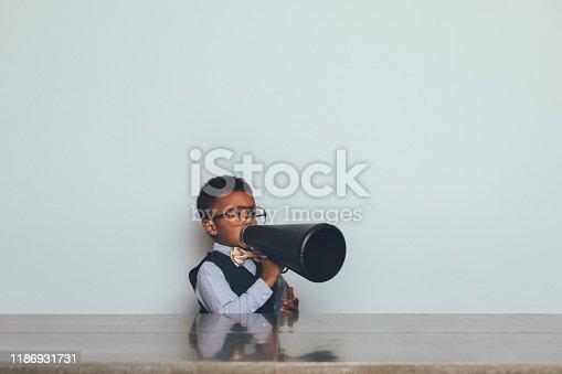 623763462istockphoto Young Nerd Boy with Megaphone 1186931731