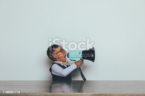 992091590 istock photo Young Nerd Boy with Megaphone 1186931779