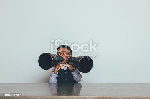 992091590 istock photo Young Nerd Boy with Two Megaphones 1186931732