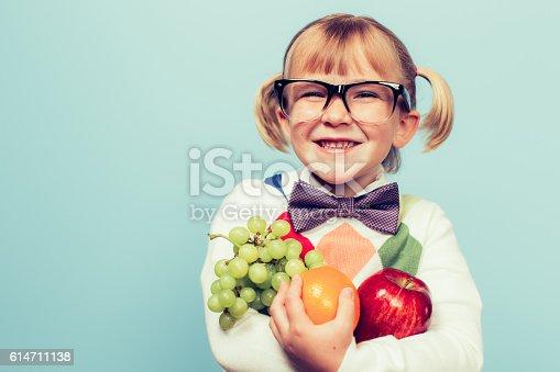 istock Young Nerd Girl Loves Eating Fruit 614711138