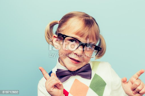 A young nerd girl with glasses sits with a silly expression on her face. She is wearing a bow tie and is thinking about mathematics and trigonometry while pointing her fingers. Retro styled.