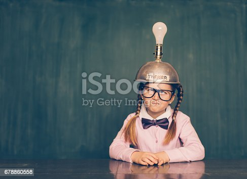 istock Young Nerd Girl With Thinking Cap 678860558