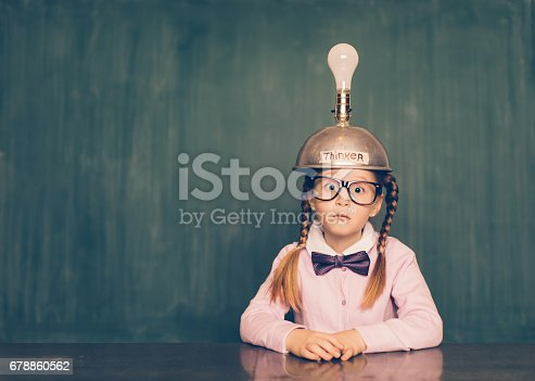 istock Young Nerd Girl With Thinking Cap 678860562