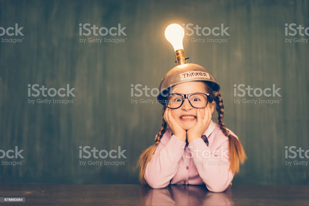 Young Nerd Girl With Thinking Cap photo libre de droits