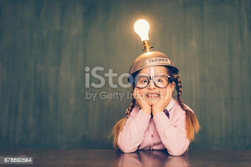istock Young Nerd Girl With Thinking Cap 678860564