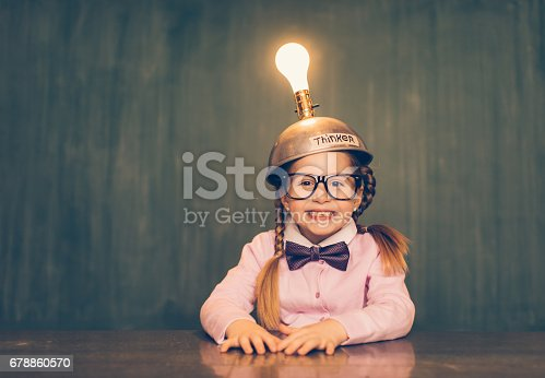 istock Young Nerd Girl With Thinking Cap 678860570