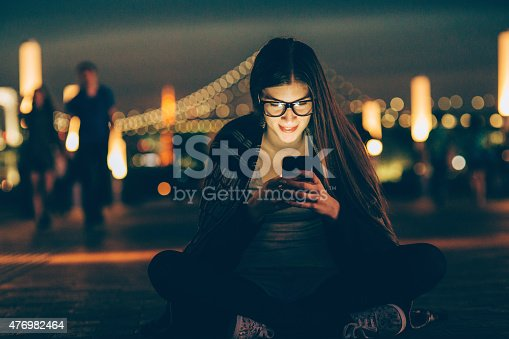 660640502 istock photo Young nerd woman texting on the phone 476982464